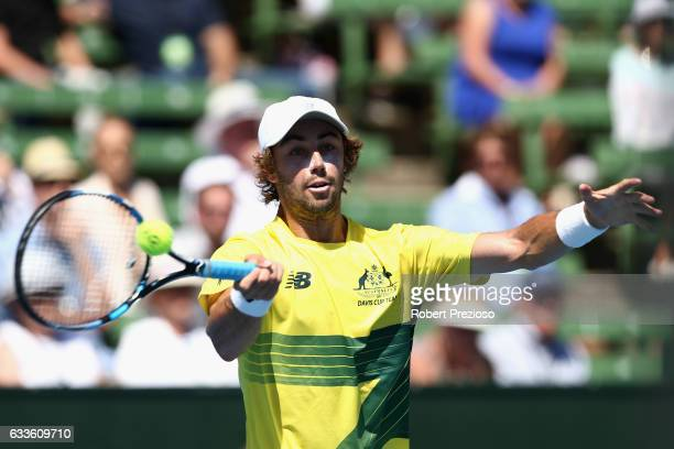 Jordan Thompson of Australia plays a forehand in his singles match against Jiri Vesely of Czech Republic during the first round World Group Davis Cup...