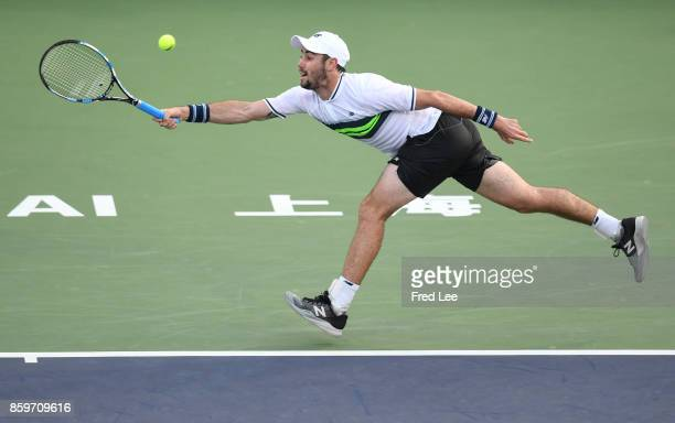 Jordan Thompson of Australia returns a shot to Diego Schwartzman of Argentina in their match during Round 1 of Men's Single on Day 3 of 2017 ATP...