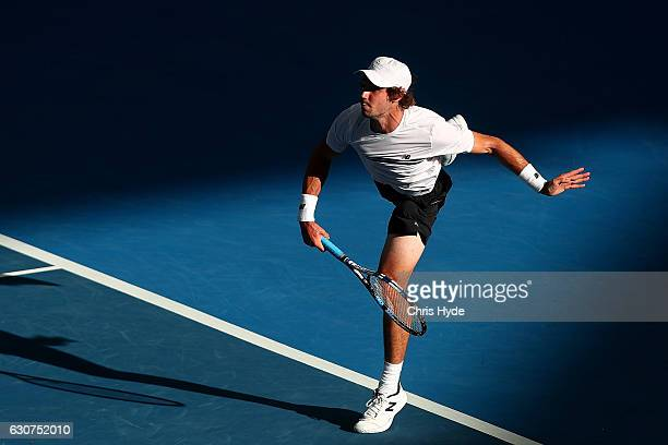 Jordan Thompson of Australia serves during his first round match against Elias Ymer of Sweden during day one of the 2017 Brisbane International at...