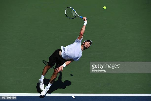 Jordan Thompson of Australia serves to Steve Darcis of Belgium during his first round Men's Singles match on Day One of the 2016 US Open at the USTA...