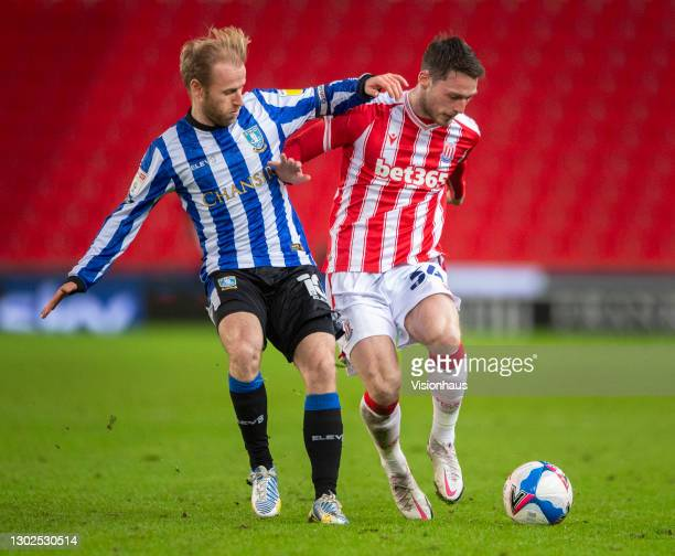 Jordan Thompson of Stoke City and Barry Bannan of Sheffield Wednesday in action during the Sky Bet Championship match between Stoke City and...