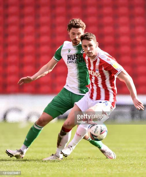 Jordan Thompson of Stoke City battles for possession with George Evans of Millwall FC during the Sky Bet Championship match between Stoke City and...