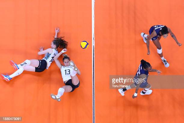Jordan Thompson of Team United States and Foluke Akinradewo react after scoring a point against Team Argentina during the Women's Preliminary - Pool...