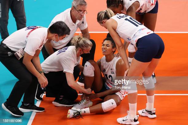 Jordan Thompson of Team United States reacts while suffering an injury against Team ROC during the Women's Preliminary - Pool B volleyball on day...