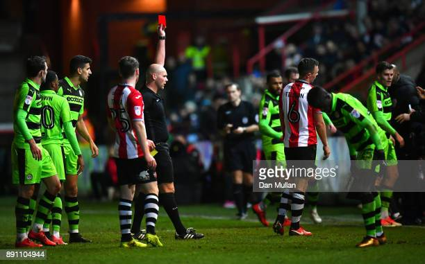 Jordan Tillson of Exeter City is shown a red card by referee Charles Breakspear during the Emirates FA Cup Second Round Replay between Exeter City...