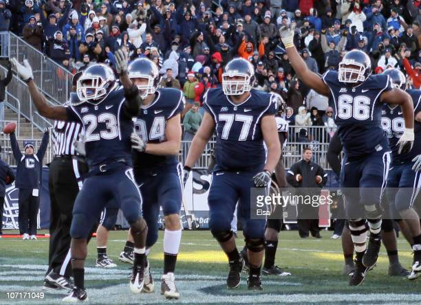 Jordan Todman of the Connecticut Huskies celebrates his touchdown with teammates Ryan Griffin Kevin Friend and Mathieu Olivier in the fourth quarter...