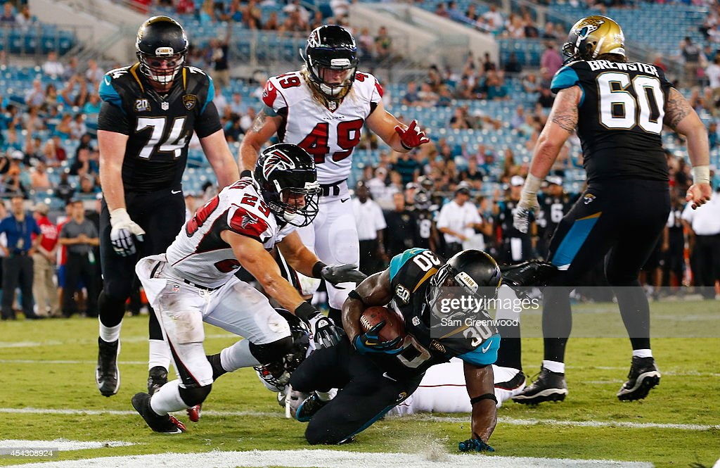 Jordan Todman #30 of the Jacksonville Jaguars crosses the goal line for a touchdown during the preseason NFL game against the Atlanta Falcons at EverBank Field on August 28, 2014 in Jacksonville, Florida.