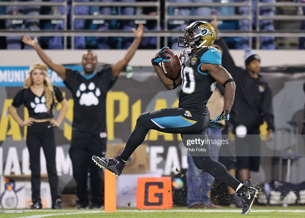 Jordan Todman #30 of the Jacksonville Jaguars crosses the goal line on a 62-yard touchdown during the fourth quarter of the game against the Tennessee Titans at EverBank Field on December 18, 2014 in Jacksonville, Florida.