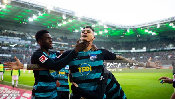 Jordan Torunarigha and Davie Selke of Hertha BSC celebrate after scoring the 03 during the game between Borussia Moenchengladbach and Hertha BSC at...