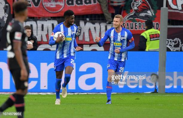 Jordan Torunarigha and Fabian Lustenberger of Hertha BSC celebrate after scoring the 21 during the Bundesliga match between Bayer 04 Leverkusen and...