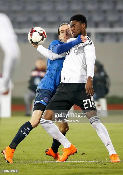 Jordan Torunarigha of Germany is challenged by Valmir Sulejmani of Kosovo during the 2019 UEFA Under21 European Championship qualifier match between...