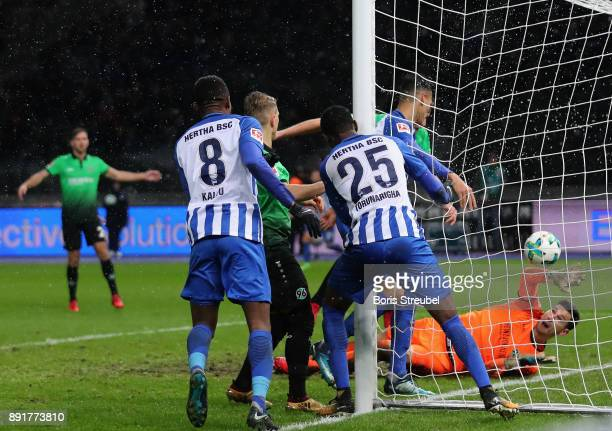 Jordan Torunarigha of Hertha BSC scores his team's second goal against goalkeeper Philipp Tschauner of Hannover 96 during the Bundesliga match...