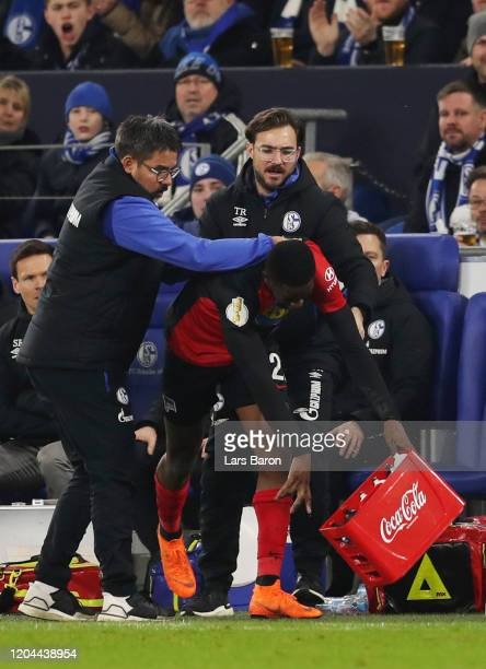 Jordan Torunarigha of Hertha BSC throws a water box on the floor on the floor as David Wagner, Head Coach of FC Schalke 04 attempts to stop him...