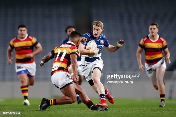 Jordan Trainor of Auckland steps against Sevu Reece of Waikato on his way to score a try during the round 13 Mitre 10 Cup match between Auckland and...