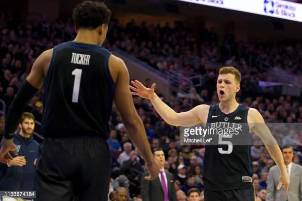 Jordan Tucker and Paul Jorgensen of the Butler Bulldogs react against the Villanova Wildcats at the Wells Fargo Center on March 2 2019 in...