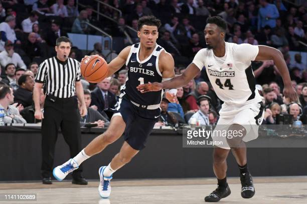 Jordan Tucker of the Butler Bulldogs dribbles around Isaiah Jackson of the Providence Friars during the Big East Men's Basketball Tournament first...