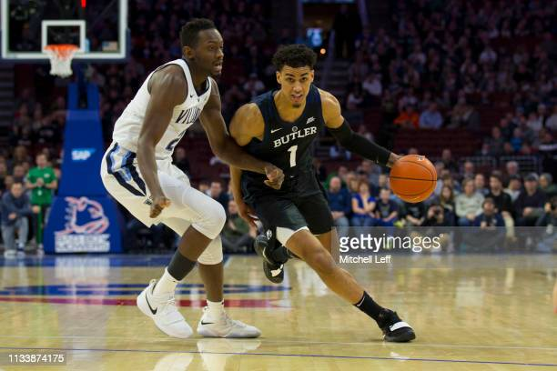 Jordan Tucker of the Butler Bulldogs dribbles the ball against Dhamir CosbyRoundtree of the Villanova Wildcats at the Wells Fargo Center on March 2...