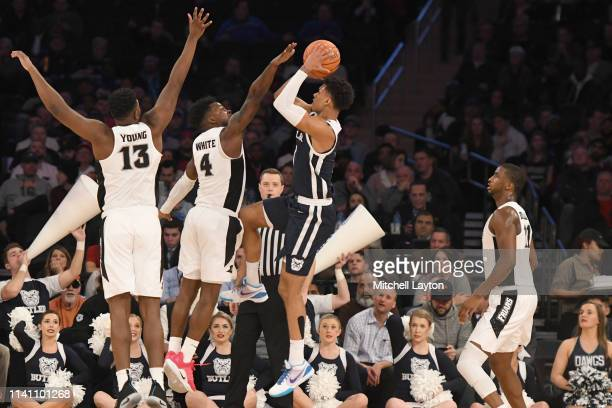 Jordan Tucker of the Butler Bulldogs takes a jump shot during the Big East Men's Basketball Tournament first round game against the Providence Friars...