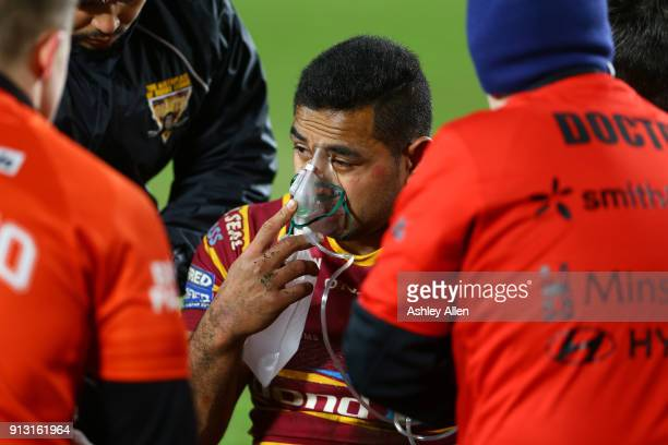 Jordan Turner of Huddersfield Giants takes in some oxygen after taking a hard hit during the BetFred Super League match between Hull FC and...