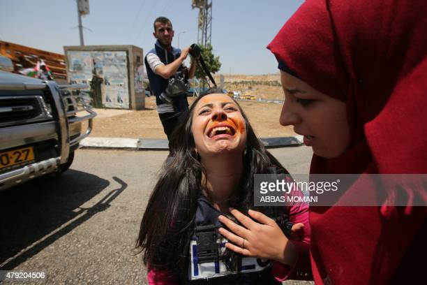 Jordan TV's journalist Nepal Farsakh reacts after Israeli security forces sprayed her face with pepper gas on July 2 as she was covering a...
