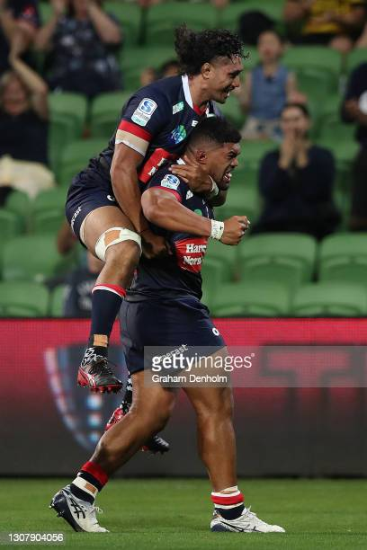 Jordan Ulese of the Rebels celebrates scoring a try during the round five Super RugbyAU match between the Melbourne Rebels and the NSW Waratahs at...