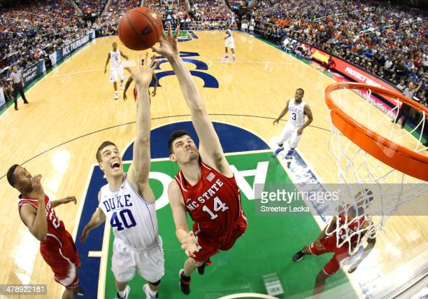 Jordan Vandenberg of the North Carolina State Wolfpack and Marshall Plumlee of the Duke Blue Devils go after a rebound during the semifinals of the...