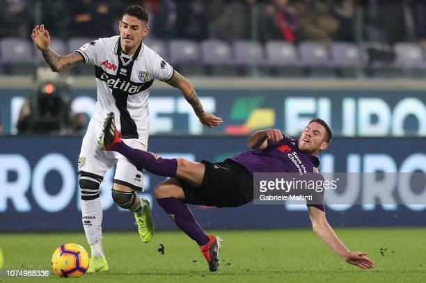 Jordan Veretout of ACF Fiorentina battles for the ball with Alessandro Deiola of Parma FC during the Serie A match between ACF Fiorentina and Parma...