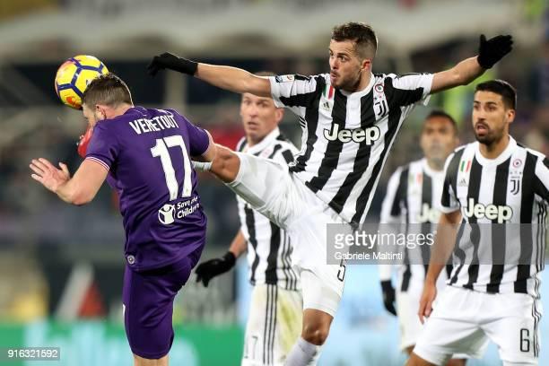 Jordan Veretout of ACF Fiorentina battles for the ball with Miralem Pjanic of Juventus during the serie A match between ACF Fiorentina and Juventus...