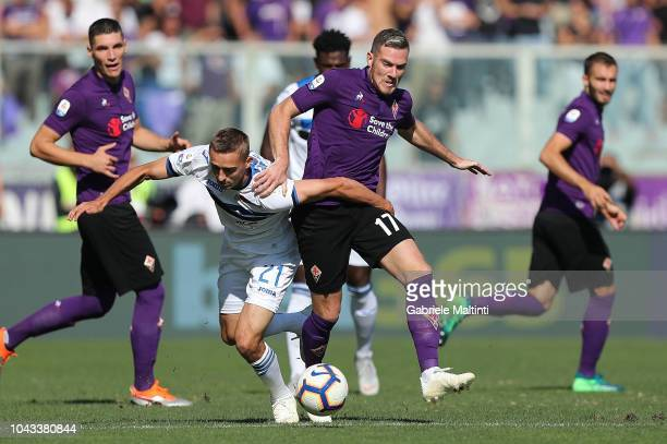 Jordan Veretout of ACF Fiorentina battles for the ball with Timothy Castagne of Atalanta BC during the Serie A match between ACF Fiorentina and...