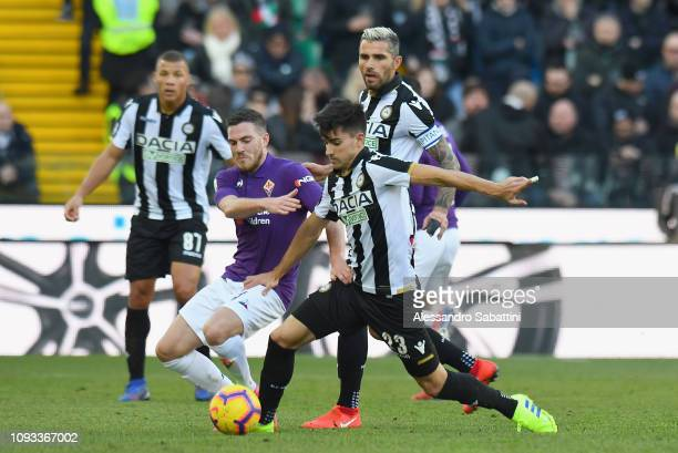 Jordan Veretout of ACF Fiorentina competes for the ball with Ignacio Pussetto of Udinese Calcio during the Serie A match between Udinese and ACF...