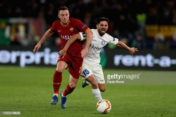 Jordan Veretout of AS Roma competes for the ball with Milad Mohammadi of KAA Gent during the UEFA Europa League round of 32 first leg match between...