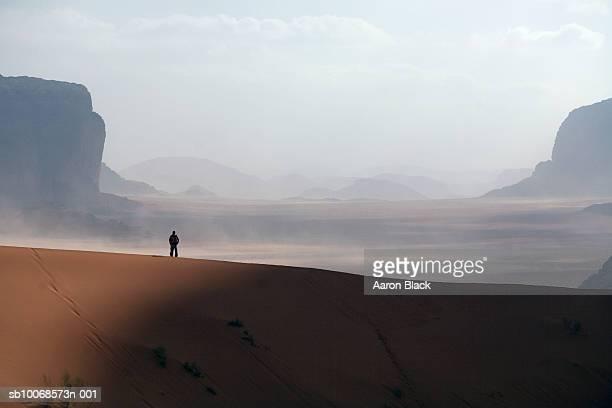 Jordan, Wadi Rum, man standing in desert