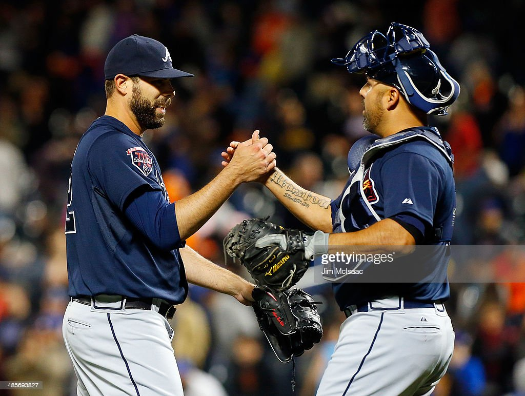 Jordan Walden #52 and Gerald Laird #11 of the Atlanta Braves celebrate after defeating the New York Mets at Citi Field on April 19, 2014 in the Flushing neighborhood of the Queens borough of New York City.