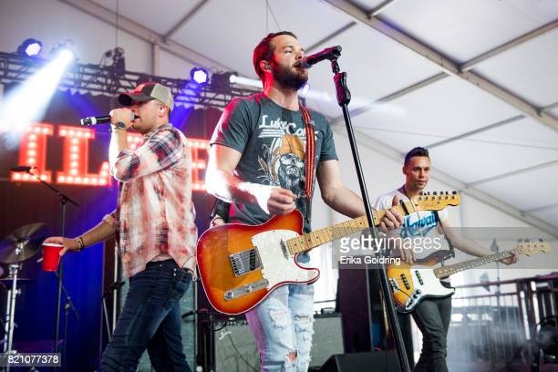 Jordan Walker and Johnny McGuire of Walker McGuire perform during Faster Horses Festival at Michigan International Speedway on July 22, 2017 in...