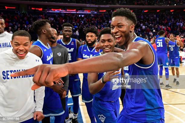 Jordan Walker and Myles Cale of the Seton Hall Pirates celebrate their team 8174 win after defeating the St John's Red Storm in an NCAA basketball...