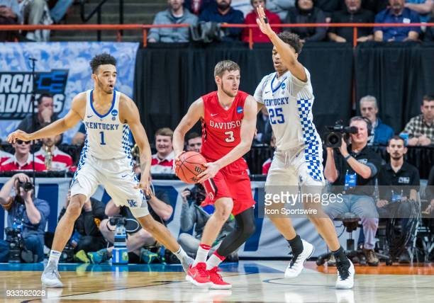Jordan Watkins of the Davidson Wildcats gets a screen from F PJ Washington of the Kentucky Wildcats during the NCAA Division I Men's Championship...