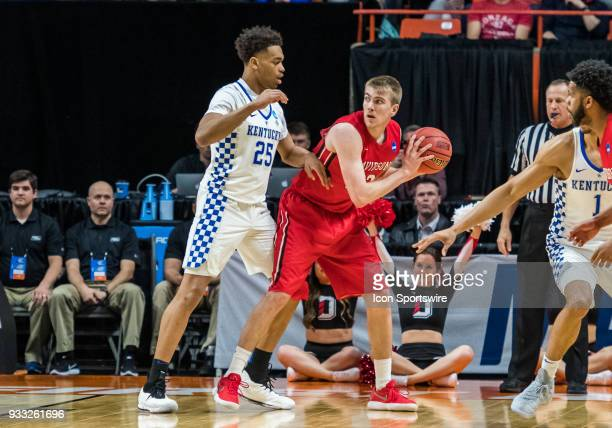 Jordan Watkins of the Davidson Wildcats looks for a passing lane around F PJ Washington of the Kentucky Wildcats during the NCAA Division I Men's...