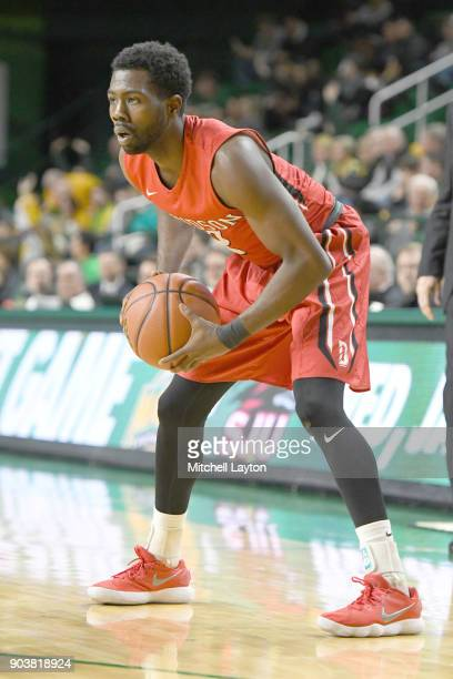 Jordan Watkins of the Davidson Wildcats looks to pass the ball during a college basketball game against the George Mason Patriots at the Eagle Bank...