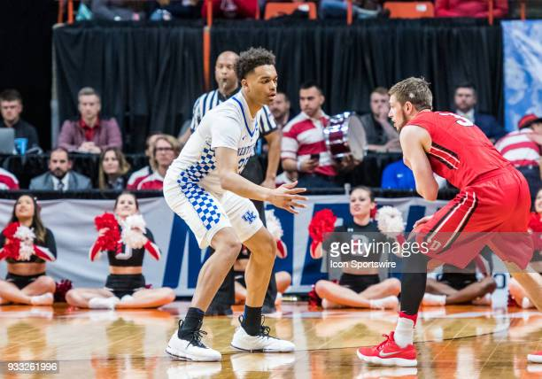 Jordan Watkins of the Davidson Wildcats moves against F PJ Washington of the Kentucky Wildcats during the NCAA Division I Men's Championship First...