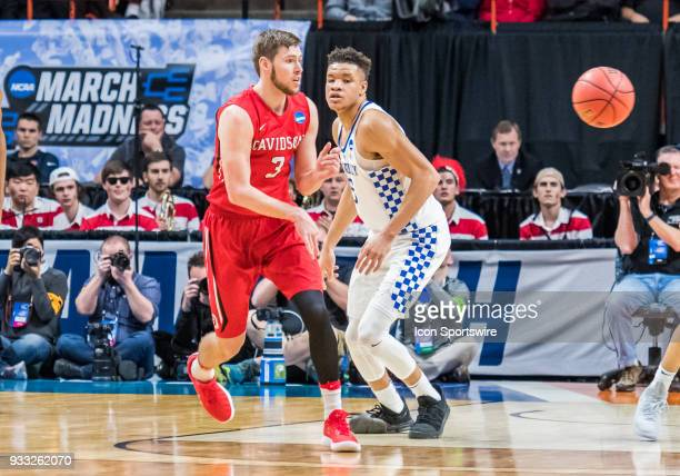 Jordan Watkins of the Davidson Wildcats passes around F Kevin Knox of the Kentucky Wildcats during the NCAA Division I Men's Championship First Round...
