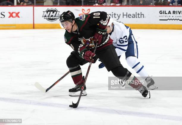 Jordan Weal of the Arizona Coyotes skates with the puck ahead of Tyler Ennis of the Toronto Maple Leafs during the first period at Gila River Arena...