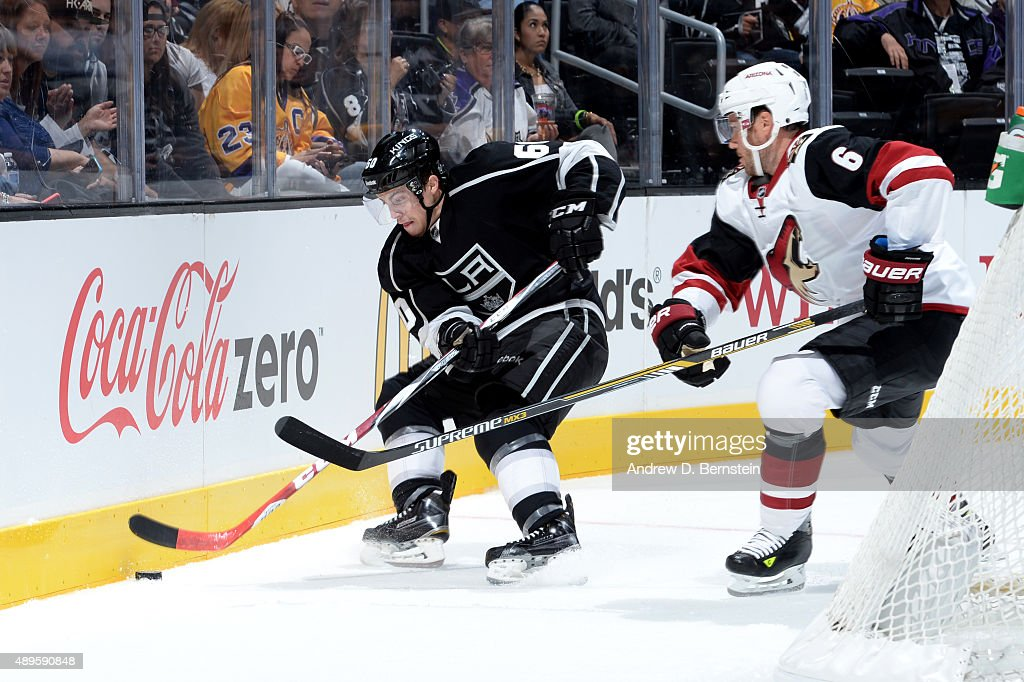 Jordan Weal #60 of the Los Angeles Kings handles the puck against Corey Potter #6 of the Arizona Coyotes at STAPLES Center on September 22, 2015 in Los Angeles, California.
