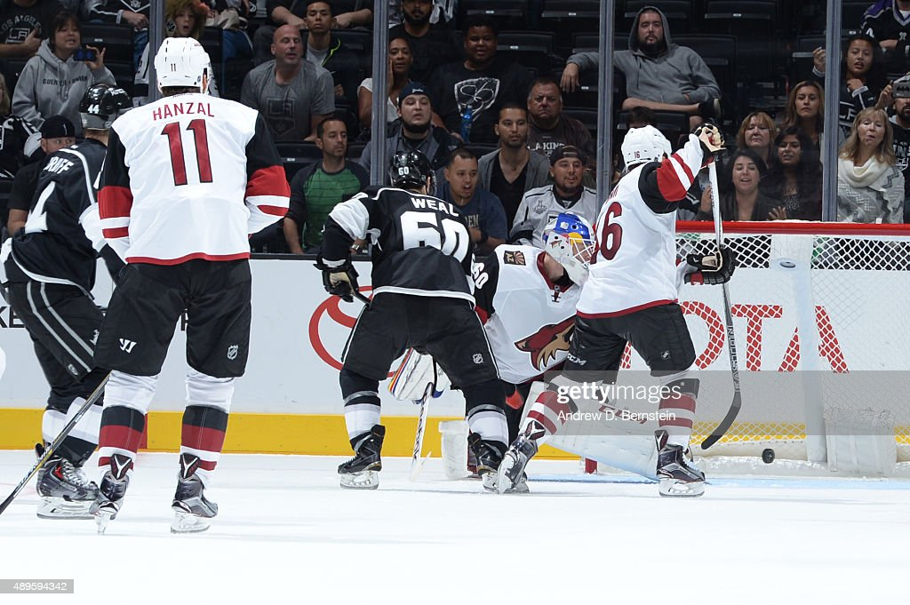 Jordan Weal #60 of the Los Angeles Kings scores the game winning goal against the Arizona Coyotes at STAPLES Center on September 22, 2015 in Los Angeles, California.