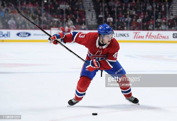Jordan Weal of the Montreal Canadiens passes the puck against pressure from the New York Islanders in the NHL game at the Bell Centre on March 21...