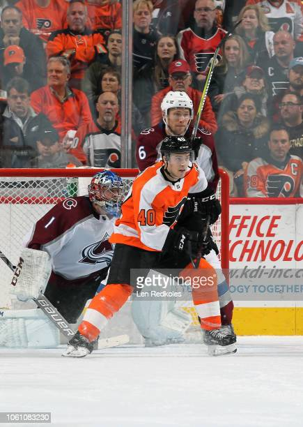 Jordan Weal of the Philadelphia Flyers battles against Erik Johnson in front of goaltender Semyon Varlamov of the Colorado Avalanche on October 22...