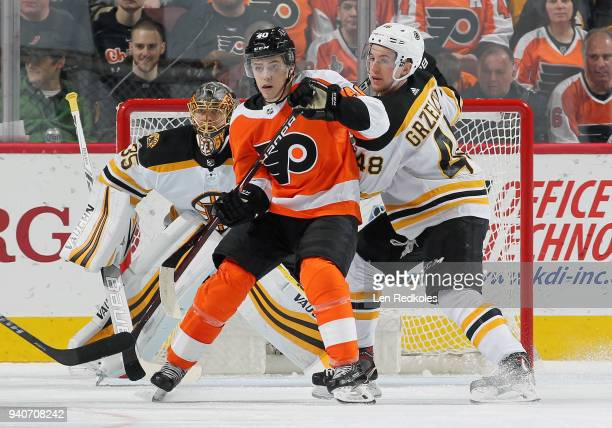 Jordan Weal of the Philadelphia Flyers battles for position in front of Anton Khudobin of the Boston Bruins with Matt Grzelcyk on April 1 2018 at the...