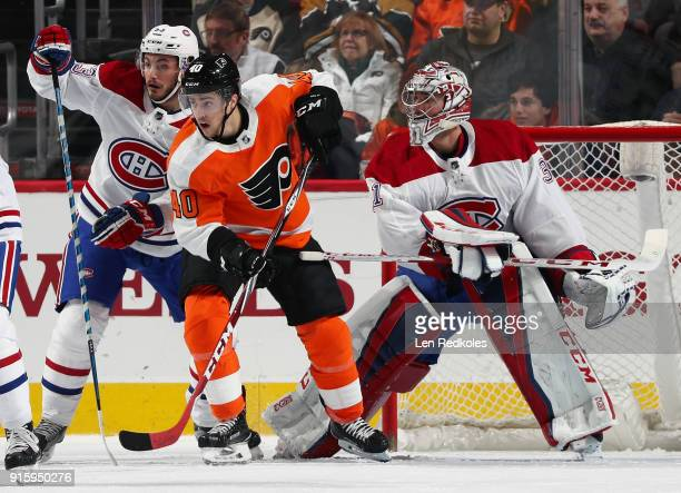 Jordan Weal of the Philadelphia Flyers battles for position with Victor Mete of the Montreal Canadiens in front of Carey Price on February 8 2018 at...