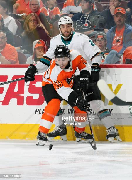 Jordan Weal of the Philadelphia Flyers battles for the puck Barclay Goodrow of the San Jose Sharks on October 9 2018 at the Wells Fargo Center in...