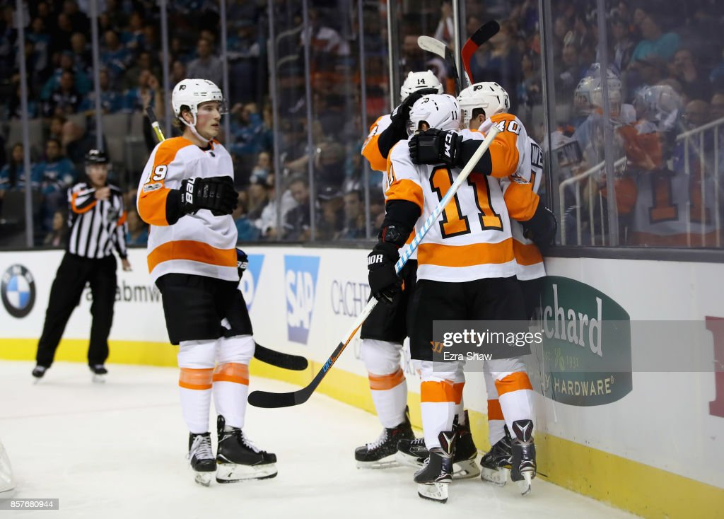 Jordan Weal #40 of the Philadelphia Flyers is congratulated by teammates after he scored against the San Jose Sharks in the first period at SAP Center on October 4, 2017 in San Jose, California.