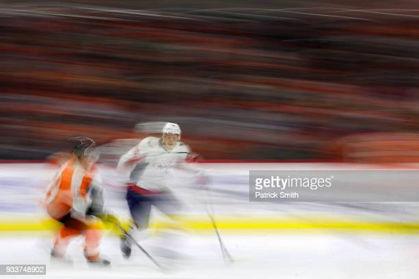 Jordan Weal of the Philadelphia Flyers skates with the puck as he is defended by John Carlson of the Washington Capitals during the first period at...